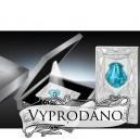 Luxusní mince s tyrkysovým krystalem Swarovski ve tvaru lastury s indigovým osvětlením