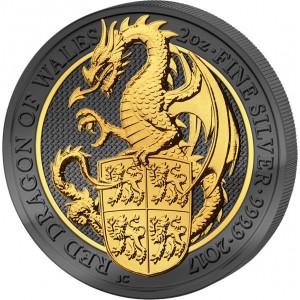 Červený drak s erbovním štítem - symbol Walesu na stříbrné mincí zušlechtěné černým rutheniem a ryzím zlatem