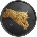 Rys kanadský na stříbrné mincí zušlechtěné černým rutheniem a ryzím zlatem