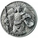 Archanděl Gabriel - ochránce pravdy na atraktivní minci s vysokým reliéfem a drahokamem